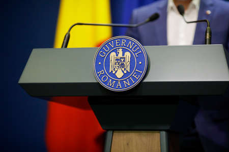 Bucharest, Romania - April 17, 2021: Details with the Romanian Government logo during a press conference held by a politician. Editorial
