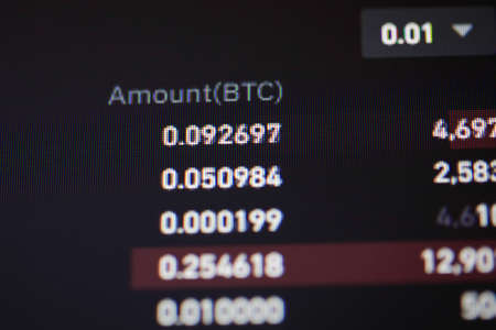 Shallow depth of field footage with details of Bitcoin cryptocurrency on a crypto exchange app, on a digital screen.