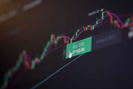 Shallow depth of field footage with details of Bitcoin cryptocurrency price fluctuations on a crypto exchange app, on a digital screen.