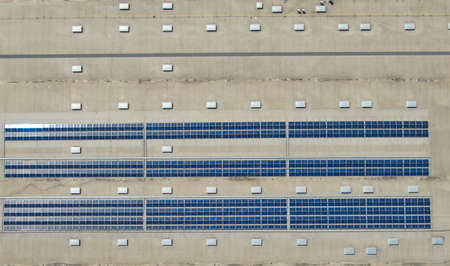 Aerial image of industrial solar panels on the roof of a hypermarket.