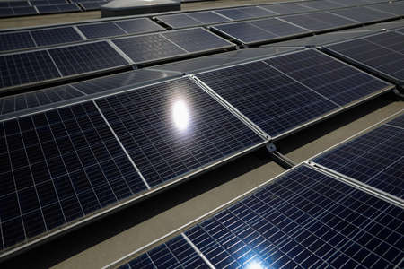 Industrial solar panels on the roof of a hypermarket.