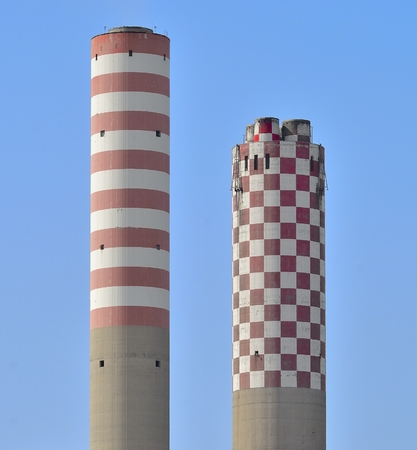 smokestacks: modern life, civilization, well-being, but also pollution and degradation