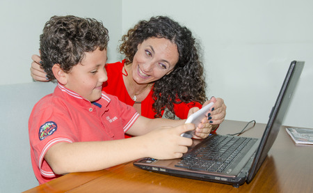 8 12: Mom and son together, play, study, get help.