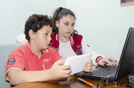 get help: Sister and brother together, play, study, get help.