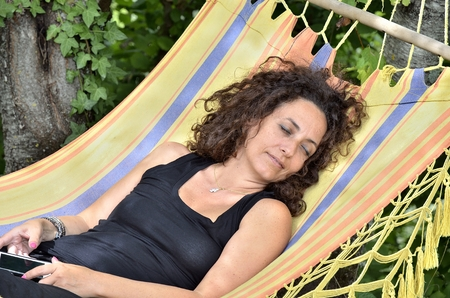 fluency: On vacation you can choose to go to the mountains and relax in a hammock. Stock Photo