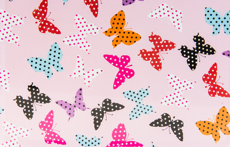 designates: Pink background with butterflies in red purple black white inside of butterflies there are dots. Much loved by girls.