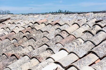 Roof with old tiles channels made of terracotta clay roofs typical Sicilian. photo