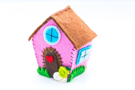 gentleness: Aback home. Home sweet home, the concept of home. Felt creations, and abstract concept of miniature house, cheerful and colorful for recurrences.