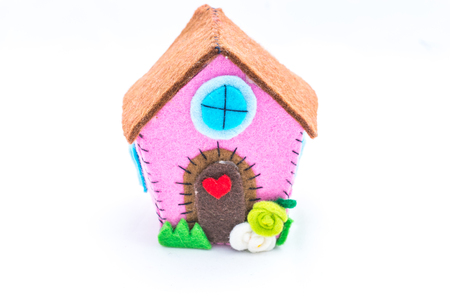 Aback home. Home sweet home, the concept of home. Felt creations, and abstract concept of miniature house, cheerful and colorful for recurrences.