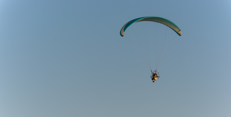 powered: Powered parachute in flight. An opportunity for anyone to experience the flight at low cost.