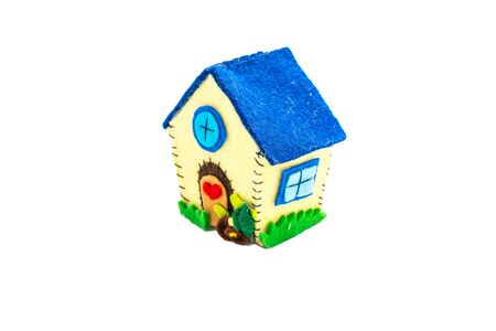 effervescence: Aback home. Home sweet home, the concept of home. Felt creations, and abstract concept of miniature house, cheerful and colorful for recurrences.