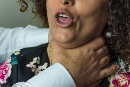 unrecognisable people: Domestic violence between man and woman, husband and wife, between lovers, between brother and sister. Colloe hands to his mouth open, you see the teeth and tongue.
