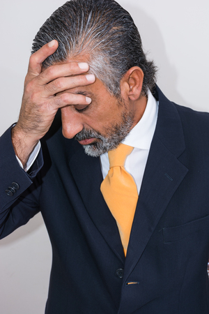 grays: Adult man, mature, in suits. Bearded, grizzled, he thinks, deep in thought. Facial expressions, making faces. Stock Photo