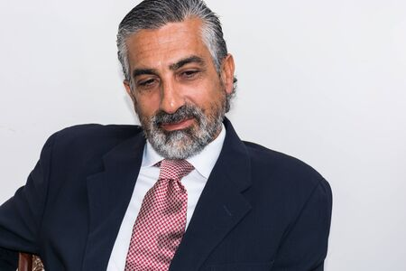 grizzled: Handsome businessman in his studio, in suits, bearded, grizzled.