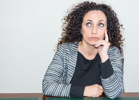 blacks: Mature Woman with pensive eyes high. With curly hair and blacks and green eyes.