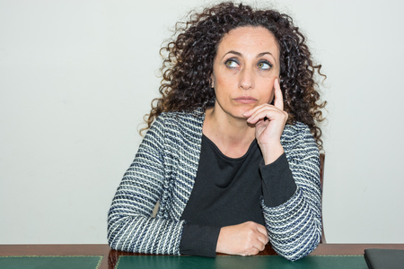 amiable: Mature Woman with pensive eyes high. With curly hair and blacks and green eyes.