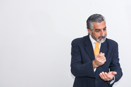 persuades: Businessman, engaged in business education. In suits, shaking hands and slams his fist on the other hand.