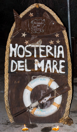 where to eat: Signboard typical Italian restaurants. With jacket and oar, symbols of the sea and weighs, typical of seaside restaurants where you eat fish.