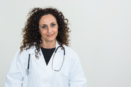 medical field: Doctor with curly hair and blacks and with green eyes, use a tablet of white color. The new technologies used in the medical field. Stock Photo