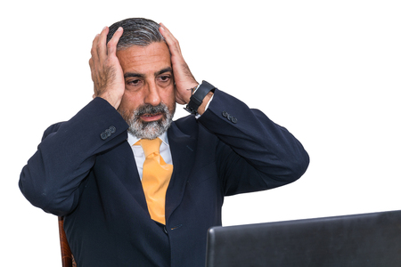 loss leader: Desperate businessman. Alone in his office, in front of the desk with the computer, it panic, depression.