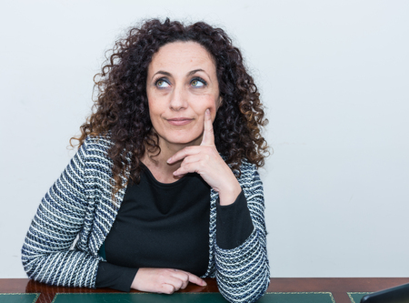 intriguing: Mature Woman with pensive eyes high. With curly hair and blacks and green eyes.