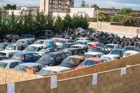 Expanse of cars in demolition. Ready for recycling or destruction. Stock Photo