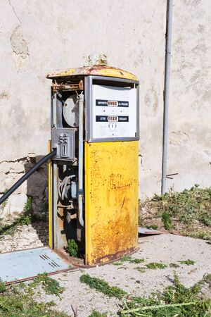 fuelling pump: Distributor or gas pump, abandoned. Isolated, old and rusty in a war zone, a symbol of power, the concept of abandonment. Abstract pollution. Old gas station. In war zones. Stock Photo