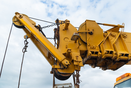 erection: For roadside assistance cranes. Wrecker for heavy vehicles. Breakdown on the road. Stock Photo
