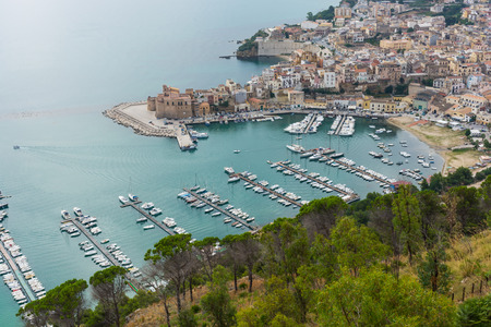 Panorama of the port of Castellammare del Golfo. Ancient Sicilian fishing village. Harbor with moored yachts. The places of Montalbano, TV dramas.
