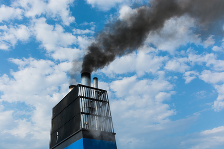 Aboard, chimney of a ferry or cruise ship, black smoke. Pollutes the atmosphere also to make vacation, travel for business reasons. Stock Photo
