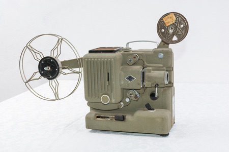 imprinted: old film projector. projects, one frame imprinted on film, and through a lens focuses the resulting image on a screen. Stock Photo