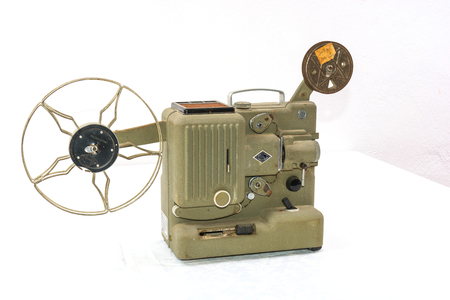 old film projector. projects, one frame imprinted on film, and through a lens focuses the resulting image on a screen. Stock Photo