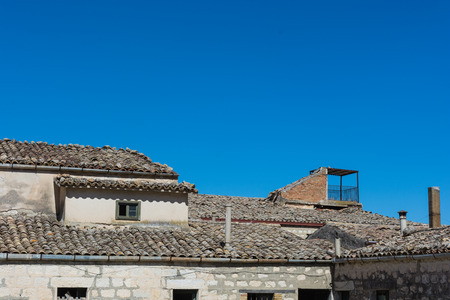 Ancient Sicilian rural architecture. Roofs with old clay tiles. All uninhabited houses. Old buildings. The places of Montalbano, TV dramas. A novel by Andrea Camilleri, Inspector Montalbano.