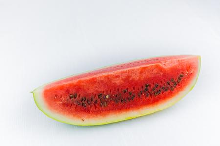 Watermelon cut in half or in segments.Typical half-moon. Sicilian or Mediterranean summer fruit. On white background Cut. graphic resource.