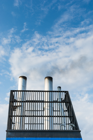 reasons: Aboard, chimney of a ferry or cruise ship, black smoke. Pollutes the atmosphere also to make vacation, travel for business reasons. Stock Photo
