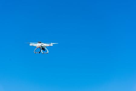 Abstract and conceptual child playing with a drone. Remote sensing. La felicit� di un bambino con un giocattolo moderno e pericoloso. Stock Photo