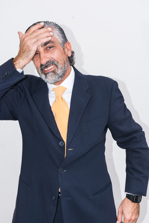 Adult man, mature, in suits. Bearded, grizzled, he thinks, deep in thought. Facial expressions, making faces. Reklamní fotografie