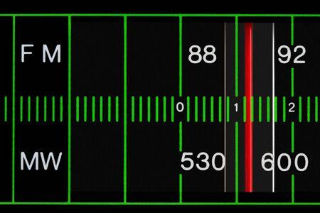 fm: black vintage radio tuner closeup with fm and mw station Stock Photo