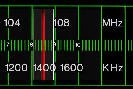 black vintage radio tuner closeup with mhz and khz frequency photo