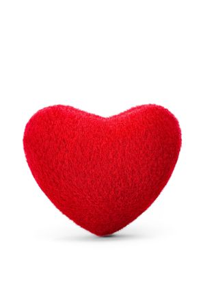 red pillows: soft velvety red heart isolated on white background