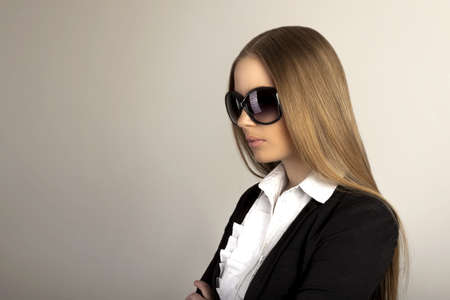 Beautiful blonde woman with sunglasses in studio Stock Photo
