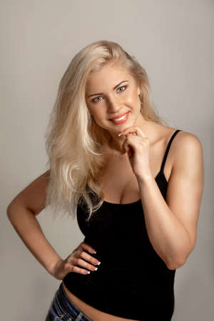 Casual young woman with a friendly-smile Stock Photo