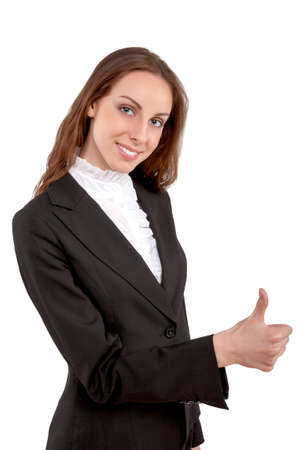 Young attractive businesswoman showing thumbs up photo