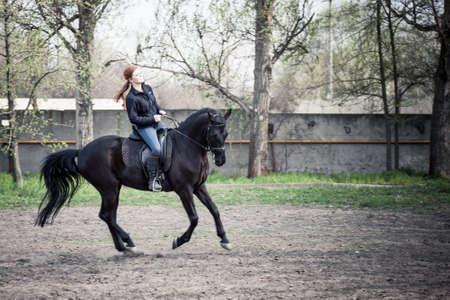 Young Beautiful Woman riding horse Stock Photo
