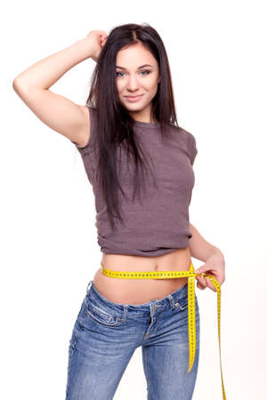 Young Beautiful Attractive Gym Woman Measuring Her Waist Stock Photo