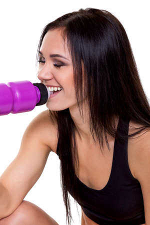 Fitness woman drinking water - Stock Image