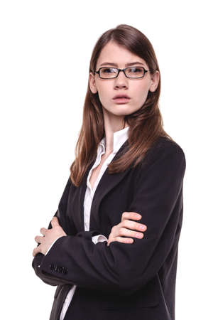 Attractive young brunette businesswoman standing with her arms crossed Stock Photo