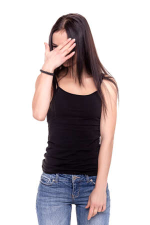 ashamed: Young Ashamed Woman Smiling and Covering her face with hand