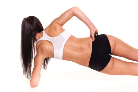 pushup: Beautiful young woman working out in the fitness studio - Pushup Stock Photo