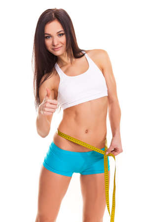 Young Woman measuring her waist - Stock Image